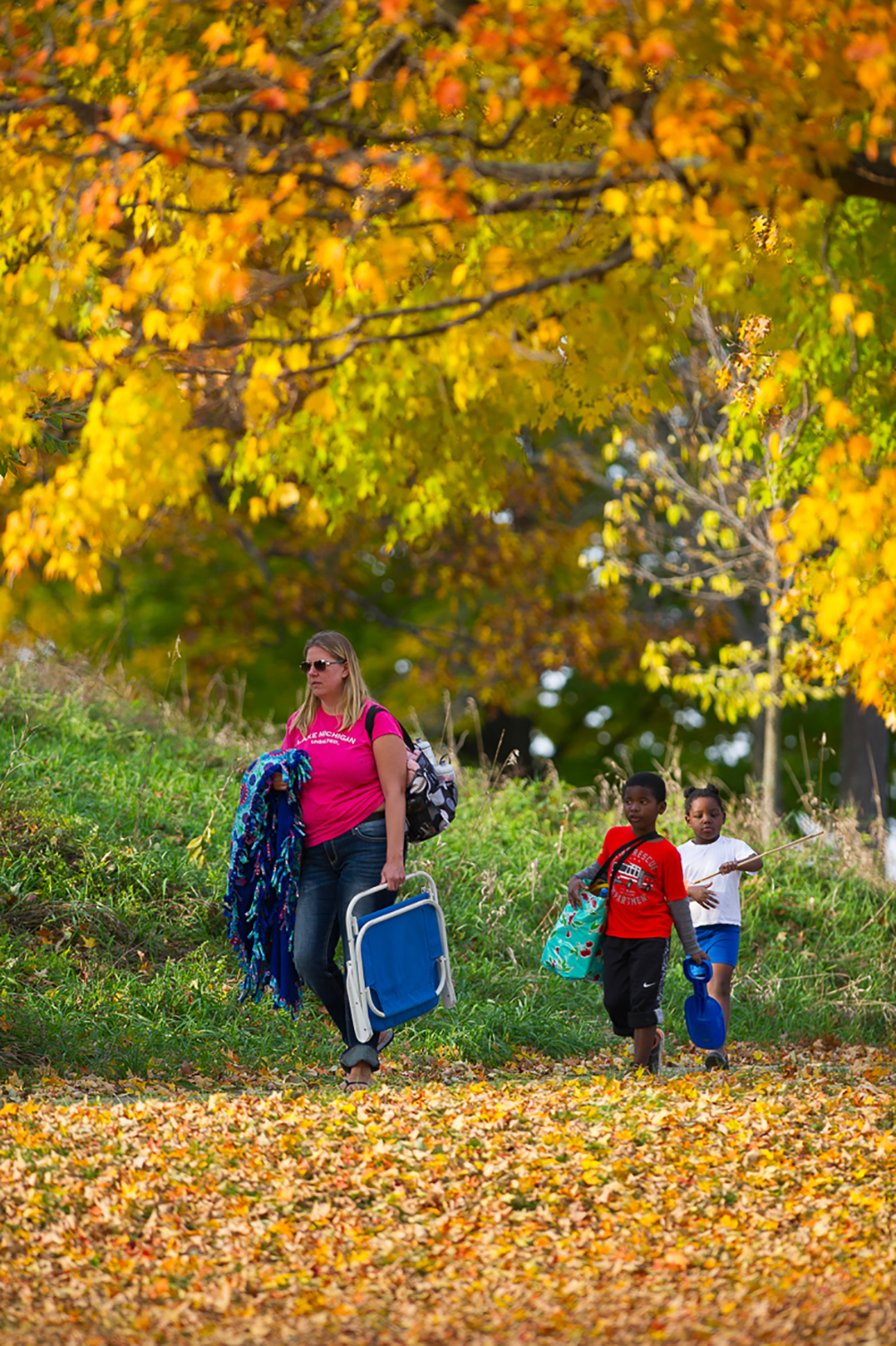 A family on a fall camping outing at the Pinckney Recreation Area, which is located in Livingston and Washtenaw counties.