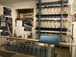 exhibit showing beakers used to raise fish from eggs