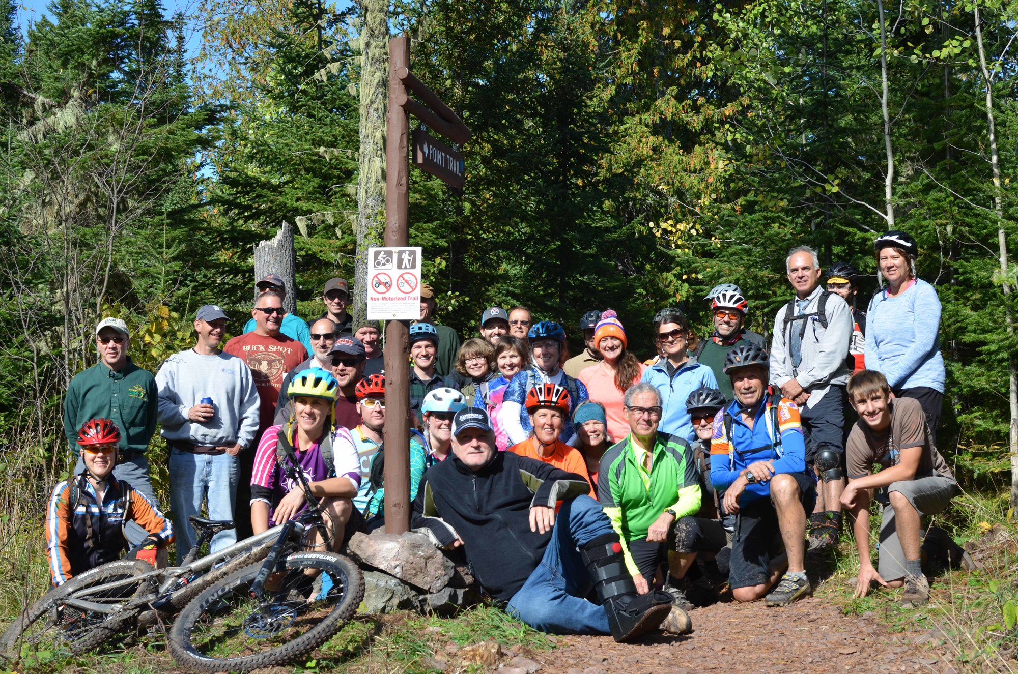 A group of mountain bikers and others gathered Thursday at High Rock Bay to celebrate the opening of a new section of the Keweenaw Point Trail.