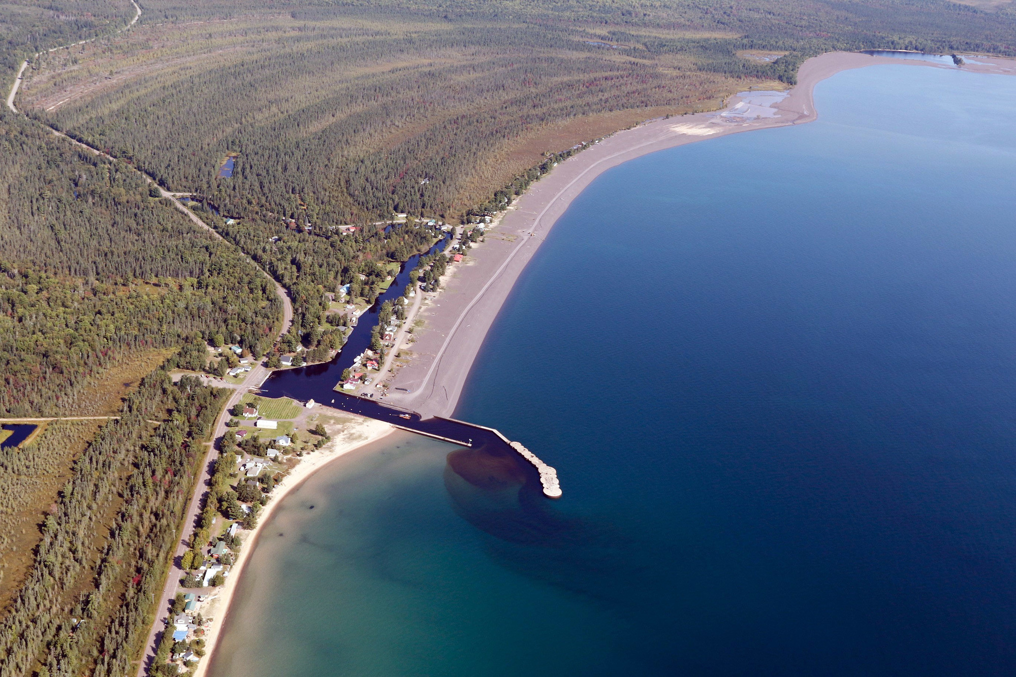 This aerial photo shows the stamp sands deposited along the coast north of the Grand Traverse Harbor and the natural beaches that lie to the south.