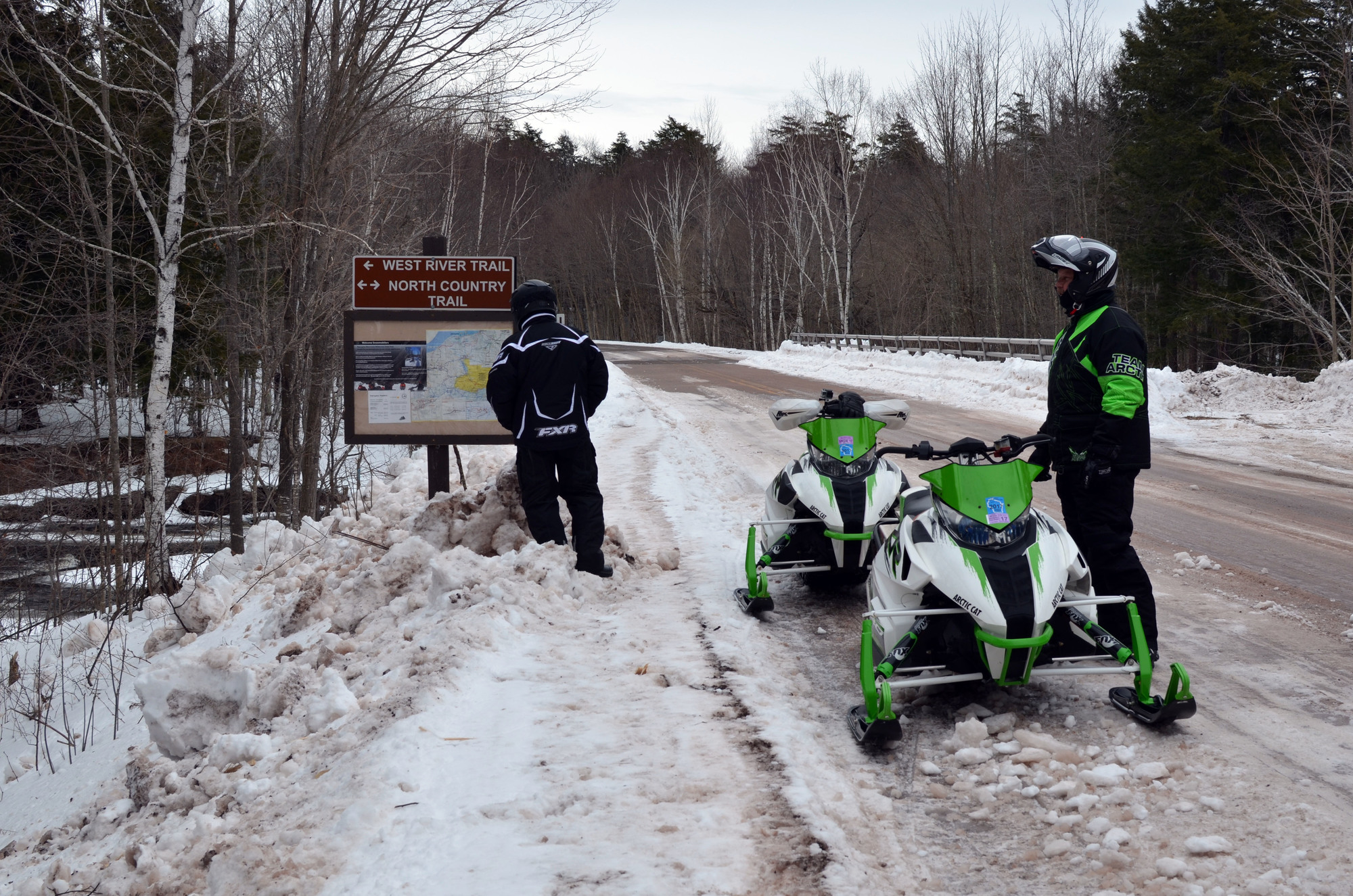 Snowmobilers stop to look at a trail map along the South Boundary Road at Porcupine Mountains Wilderness State Park in Gogebic County.