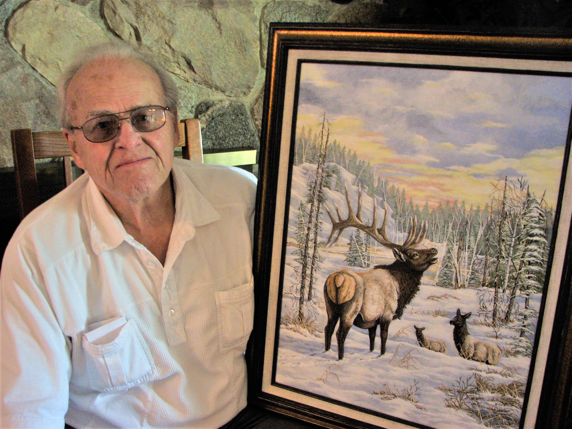 Gary Cole of Dearborn, shown here with his acrylic painting of elk, was the winner of the 100th anniversary of elk poster contest.