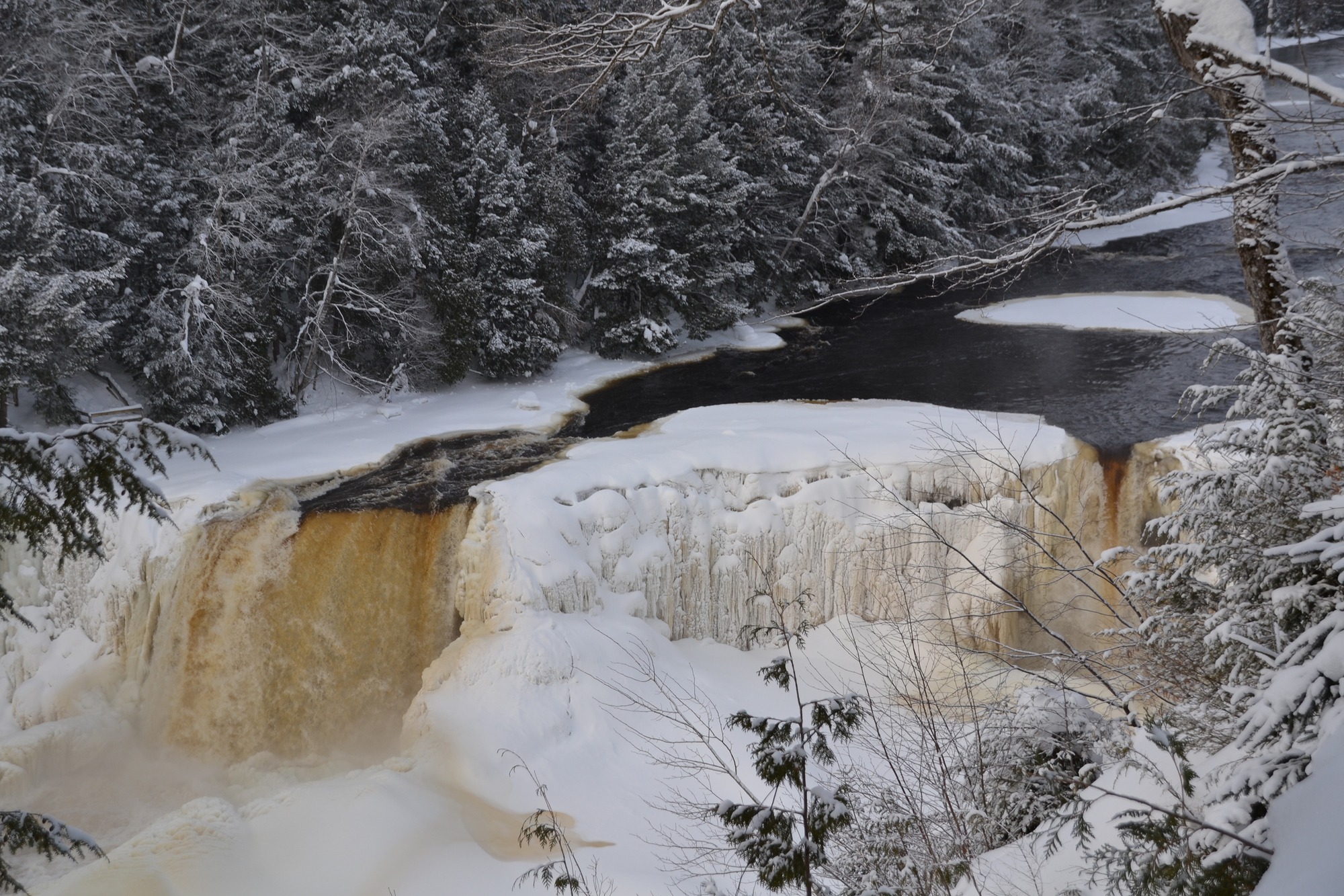 Dnr dont hibernate recreate winter fun at michigan state parks the upper tahquamenon falls provide a beautiful wintry backdrop for outdoor activity m4hsunfo