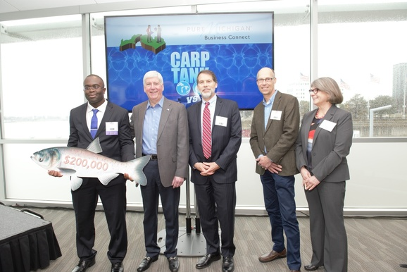 Governor Rick Snyder with Asian Carp Challenge winner