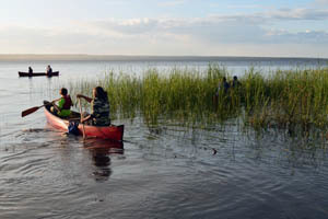Canoeists paddle out into Lake Michigan in Delta County.