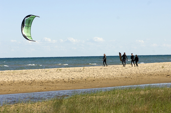 Beachgoers at Tawas Point State Park in Iosco County.