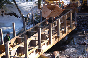 Workers are shown replacing the Mud Creek Bridge in Gogebic County.