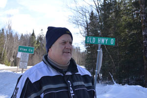 Landowner and snowmobile trail proponent Bill Lafond stands at the Michigan-Wisconsin border, just off Trail No. 11 South.