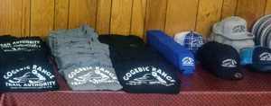 Gogebic Range Trail Authority sweatshirts and other merchandise laid out for the club's fundraising event.