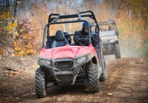 ORV riders on wooded trail