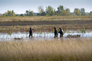 Waterfowl hunters, like these out on a day trip, benefit from wetland areas.