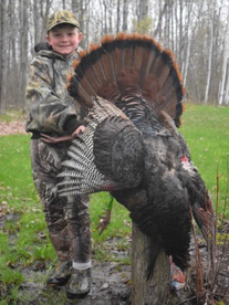 boy hunter with turkey he killed