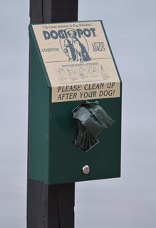 A dog litter bag dispenser is shown at F.J. McLain State Park in Houghton County.