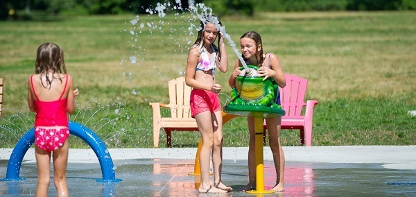 Girls playing in the spray at Bay City State Park