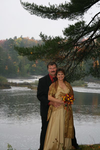 Jon and Julie Sovinski of Fremont pose for a wedding photo at the Lower Tahquamenon Falls.