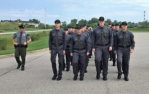 Recruits march in formation during the first week of Conservation Officer Recruit School in July 2017.