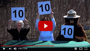 Thumbnail image from a Michigan DNR video that humorously addresses the need for thorough dousing of campfires, especially during high danger times.