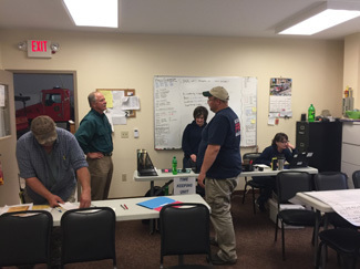 DNR Director Keith Creagh visits with the incident management team in Houghton County.