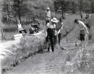 Workers test a stream shocker in this undated photo.