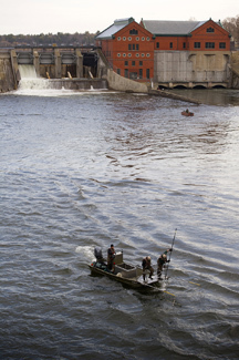 A DNR fisheries crew works to collect walleye below the Croton Dam on the Muskegon River.