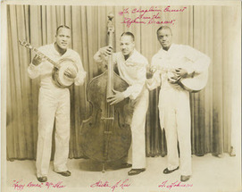 Three men, the Jackson prison jazz band, pose with a banjo, upright bass, and a guitar