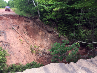 A severe trail washout along a trail near Lake Linden in Houghton County.