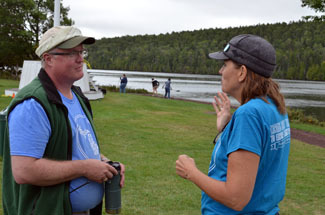 Patty Janes, right, talks with Doug Rich of the Michigan DNR at Fort Wilkins.