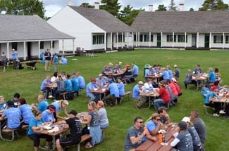 Some of the Michigan Cares for Tourism volunteers enjoy lunch at Fort Wilkins.