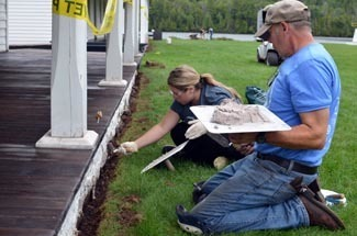 Volunteers work to rehabilitate a porch at Fort Wilkins Historic State Park.