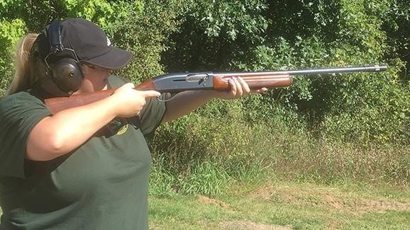 DNR staffer Makenzie Schroeder shooting a shotgun