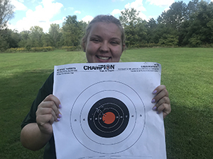 DNR staffer Makenzie Schroeder with a target from her shooting range experience
