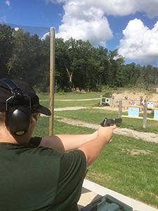 DNR staffer Makenzie Schroeder shooting a handgun