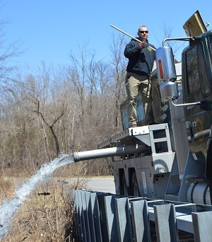 One of the DNR's specialized fish stocking trucks, releasing fish into one of the many stocking locations across Michigan.