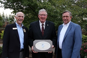 Al Stewart (center), the Michigan DNR's upland game bird specialist, recently was honored as the Dodge Sportsman of the Year.