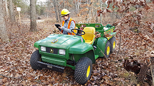 DNR forestry staffer in woods on ORV doing mapping work
