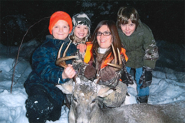 Michelle Zellar and her children after a successful deer hunting adventure.