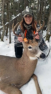 Michelle Zellar and the buck she shot this year.