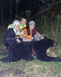 Michelle Zellar and her twins after a successful black bear hunt.