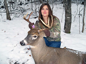 Michelle Zellar with the 7-point buck she described bagging in the story.