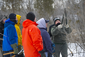 DNR staffer shows volunteers how to cut invasive shrubs