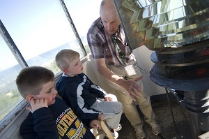 Volunteers in the Tawas Point Lighthouse keeper's program are trained to provide tours in the lighthouse and area's unique history.