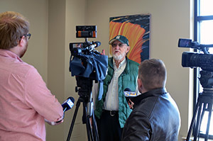 Dick Pershinske talks with the media at a council meeting earlier this year in Marquette Township.