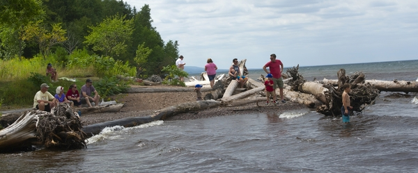 Families enjoy a rocky beach at Porcupine Mountains state park, Lake Superior