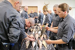 conservation officer recruits learn to identify fish species