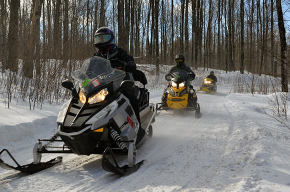 A group of snowmobilers riding right in Gogebic County during the winter of 2017-2018.