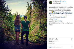 Photo of two girls looking out over the forest in Straits State Park, from Michigan DNR's instagram page