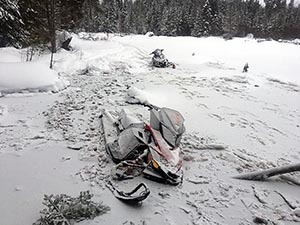 Snowmobiles fallen through the ice on Clyde Lake in Alger County.
