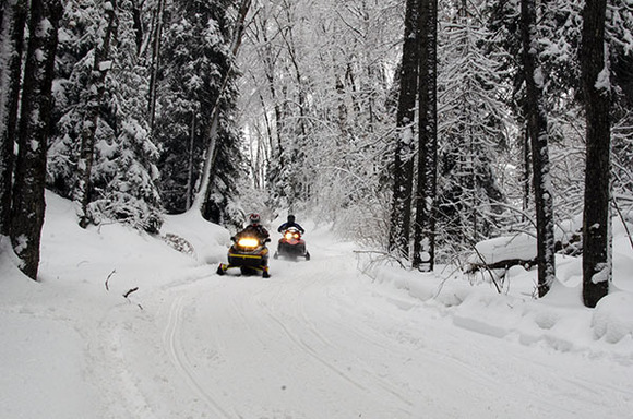 Snowmobilers enjoy a beautiful ride Wednesday afternoon along Trail No. 8 in Marquette County.