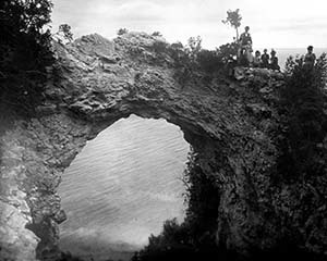 The Arch Rock at Mackinac Island is shown being visited by a group of sightseers circa 1890. (Mackinac State Historic Parks photo)