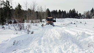 A trail groomer works along Trail No. 5 in Marquette County. (Dan Grove photo)